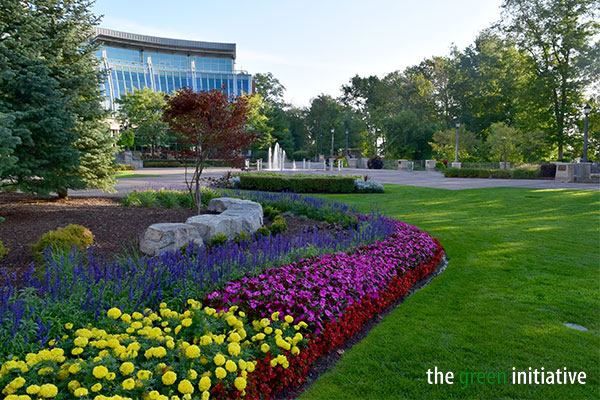 Outdoor landscape photo of blooming flowers, sprawling gardens, budding trees and green grass that surround Fallsview Casino