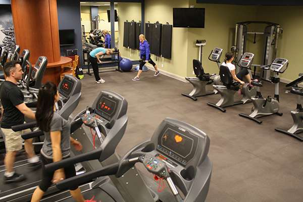 Several Niagara Casinos associates using exercise equipment in Associate Wellness Centre